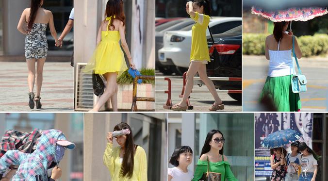 """8月8日,古城扬州最高温逼近40℃,街头出行美女纷纷""""hold""""不住,使用各种方式抵御高温。"""