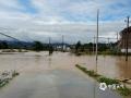 图为6月9日,受强降雨影响,崇仁县相山镇道路被淹,交通中断。摄影/蔡联颖