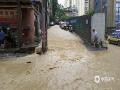 图为22日沿河县红星桥道路积水严重。(图文:崔文明 蔡成瑶 鲁颖)