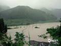 图为22日务川县茅天镇河流暴涨。(图文:邹习松 陈娟)