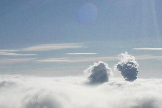 吉林市云蒸雾绕 日照云海如仙境